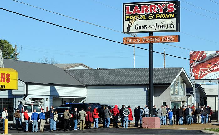 Crowds wait to enter Larrys gun shop in HSV.